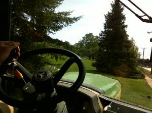 Looking over the steering wheel out the tractor window